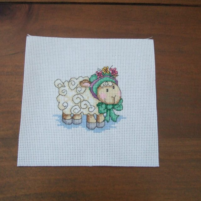 Completed Cross Stitch - Sheep in a flower bonnet
