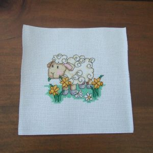 Completed Cross Stitch SHEEP WITH DAFFODILS